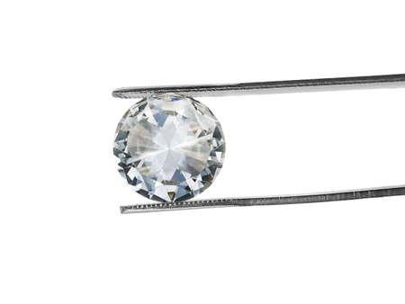 Diamond on square white background held in diamond tweezers
