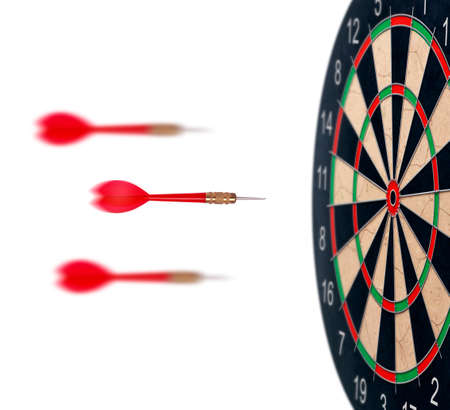 red dart arrows flying to target dartboard. Metaphor to target success, winner concept. Isolated on white background Banque d'images
