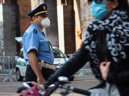tighter controls at the street food market police officer check residents fever or temperature wearing protection facial mask to prevent against contagion of coronavirus  and control limited  access