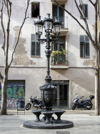 Classic fountain with lamppost in Barcelona, Spain Stok Fotoğraf