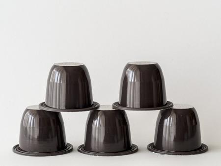 Stacked coffee capsules Stock fotó