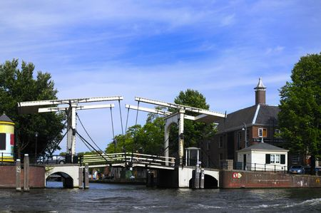 amstel: Old bridge over Amstel river in Amsterdam, Holland Stock Photo