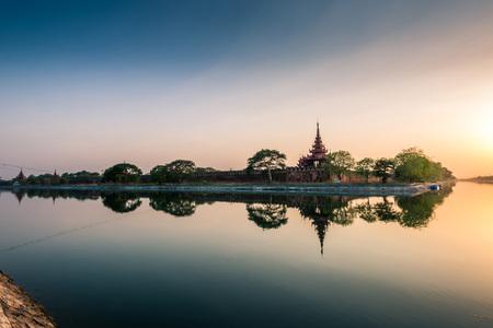 Beautiful sunset shines across the walls of the Mandalay Palace