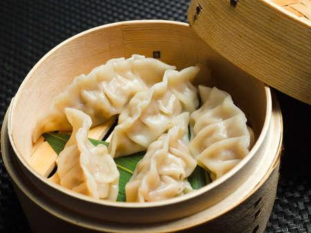 asian steamed dumplings on black background