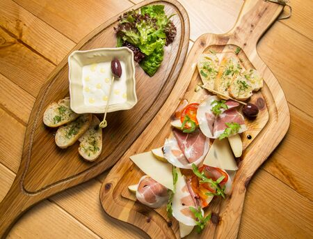 cured: Italian prosciutto, cured pork meat on cutting board
