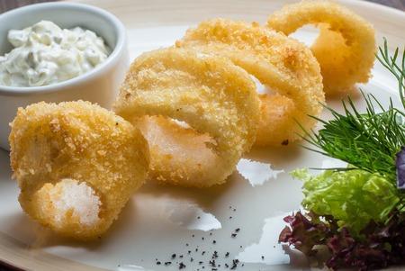 batter: Deep batter fried squid rings calamari in plate