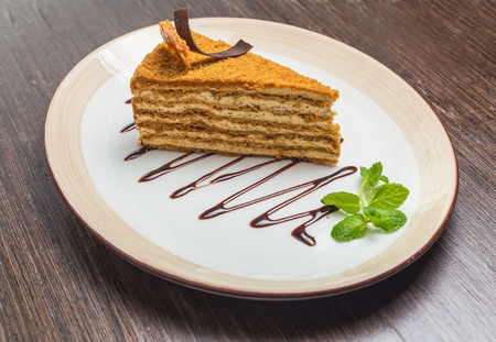 slovak republic: Slice of layered honey cake on white plate Stock Photo