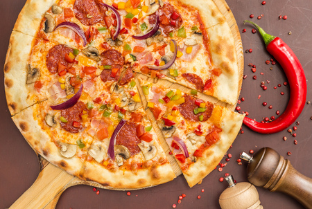 HomemadePizza with Pepperoni Sausage and Bacon Stock Photo