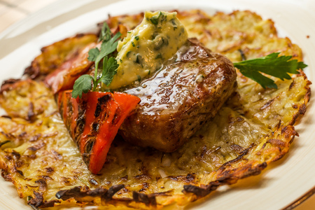 new york strip: Grilled New York strip steak with bearnaise sauce, potato wedges, and cherry truss tomatoes