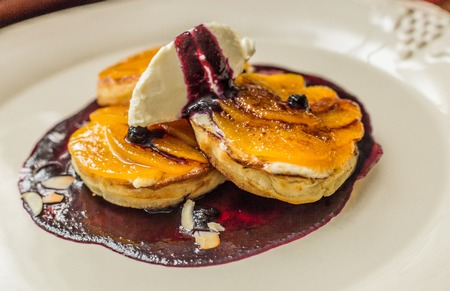 maslen: A stack of thin pancakes with honey and butter Stock Photo