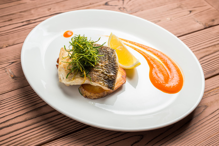 whitefish: whitefish on plate restaurant on wooden table Stock Photo