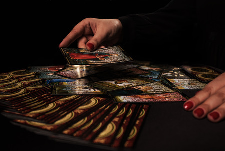 magick: Witch ritual with cards dark Stock Photo