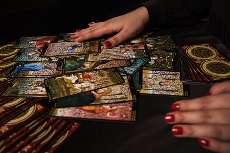 Witch ritual with cards dark Stock Photo
