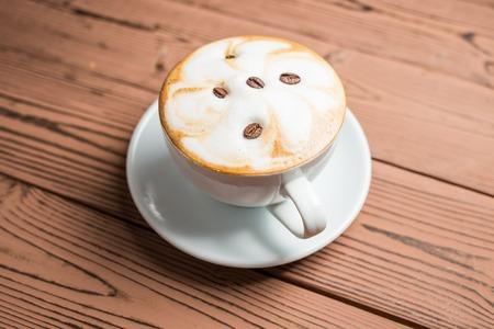 stiring: Cappuchino in a white cup, restaurant