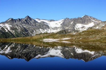 Tremor Mountain and Mount Macbeth reflected in Russet Lake (Garibaldi Park, British Columbia, Canada)