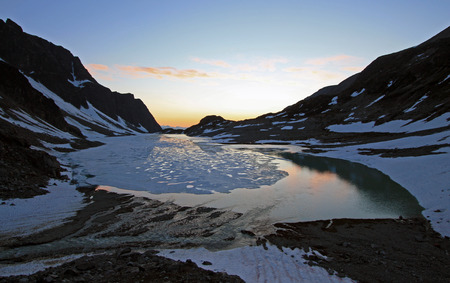 A Mountain Lake At Sunset Stock Photo