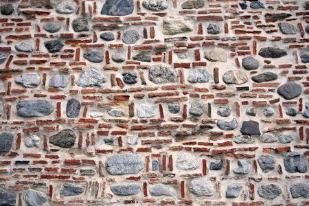 Texture of an old brick and stone wall.