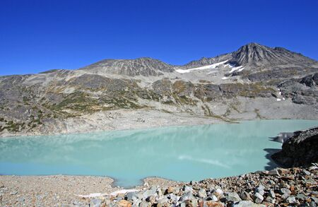 Wedgemount Lake with Cook and Weart Mountains in the background Garibaldi Provincial Park of British Columbia, Canada. Stock Photo