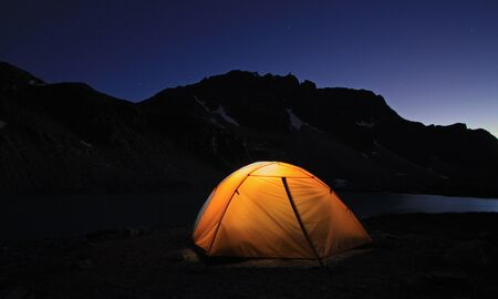 Illuminated Tent at Wedgemount Lake in Garibaldi Provincial Park of British Columbia, Canada. Stock Photo
