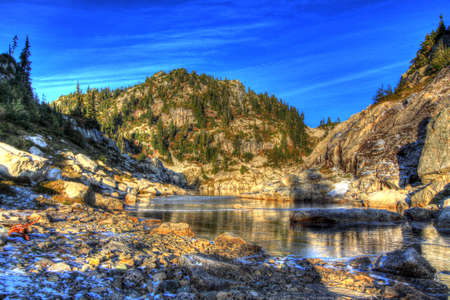 Frozen lake and mountain at sunset, Coast Mountains of BC, Canada. HDR image.