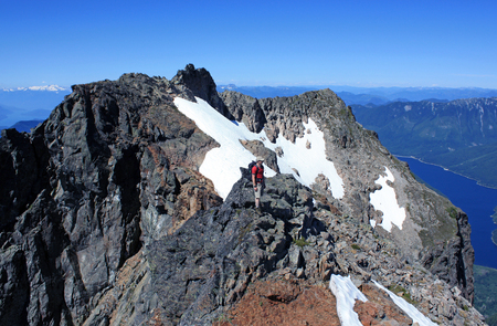 Happy hiker on the ridge of Lady Peak in Cheam Range, Cascade Mountains near Chilliwack, British Columbia, Canada. Stock Photo