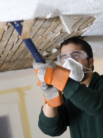 Ceiling Fix  man scraping plaster from ceiling lathe  renovation