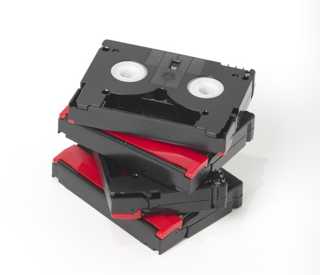 4 stacked mini dvc tapes  shot on white  clipping path provided to place tapes on any background for compositing  Imagens