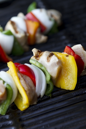 kabob: vertical shot of cooked chicken kabob on a grill  shallow depth of field Stock Photo