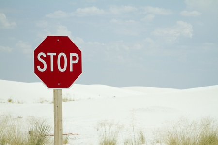 a stop sign post at the beach  white sand in the background  Stock Photo - 19161277