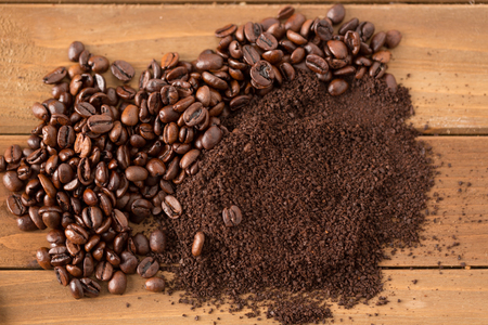 pile of coffee beans and grounds from above split down the middle above