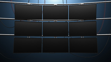 a futuristic nine panel video wall with blank screens and cords mounted on pipes Stock Photo