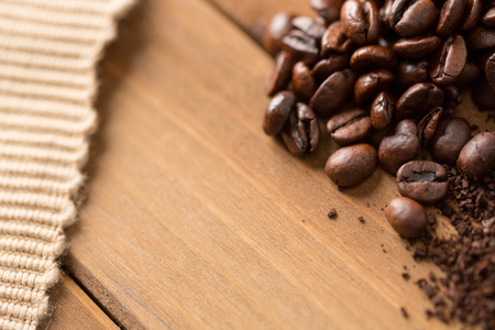 coffee beans and cloth on wood close up from above