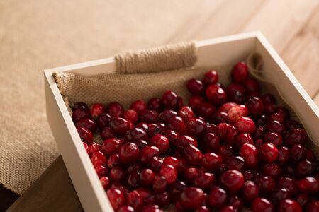 a box of cranberries on a table from above