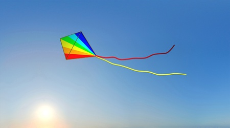 A 3d image of colored kite and sunset on blue baclgrounds.