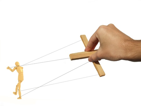 A 3d image of puppet and photograph of master hand. photo