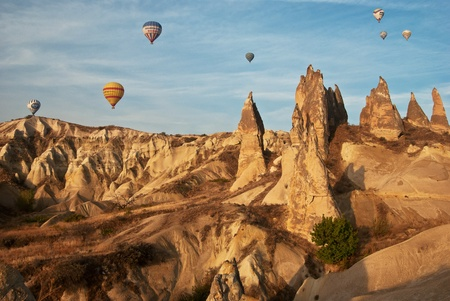 Morning balloon flight over the mountains in Cappadocia photo