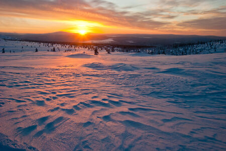 sunset in winter tundra. Lapland, Finland photo