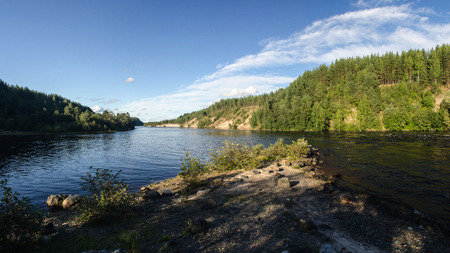 Riverside and forest in Karelia, about Girvas waterfall. Panorama. Stock Photo