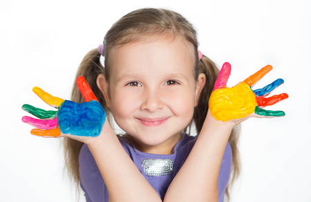 kids painted hands: happy cute girl waving with coloured hands Stock Photo