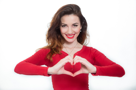hot lady in red showing heart shape Imagens
