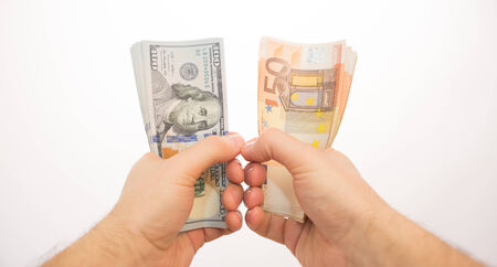 subjective: two palms handing dollars and euros