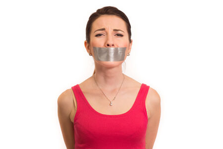 torture: woman in red with gaffer tape on her mouth experiencing emotional pain isolated