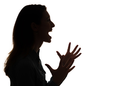 profile of screaming woman in silhouette photo