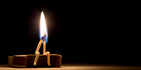 matchstick: two matches in flame as a metaphor of togertherness friendship and love