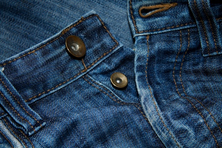close button: Close up of blue jeans with buttons Stock Photo