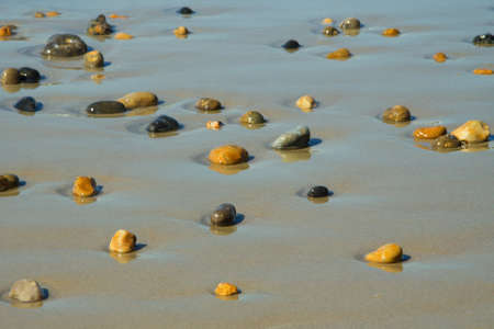 Stones on the beach background, texture photo