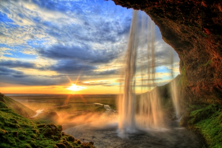 powerful: Seljalandfoss waterfall at sunset in HDR, Iceland Stock Photo