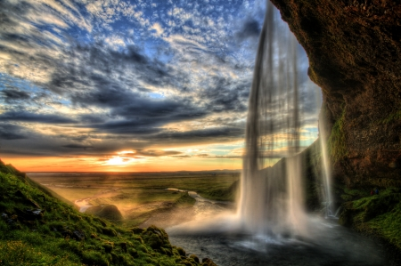 waterfall with sky: Seljalandfoss waterfall at sunset in HDR, Iceland Stock Photo