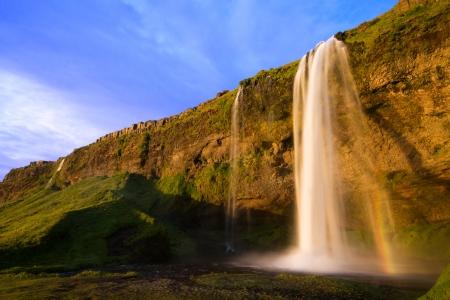 Seljalandfoss waterfall at sunset, Iceland Stock Photo