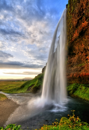 magnificent: Seljalandfoss waterfall at sunset in HDR, Iceland Stock Photo